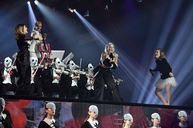 Julia Michaels, Anne Marie and Zara Larsson perform on stage with Clean Bandit during the MTV EMAs 2017 held at The SSE Arena, Wembley on November 12, 2017 in London, England.